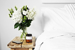 Flowers in a Vase by a Rehab Bed