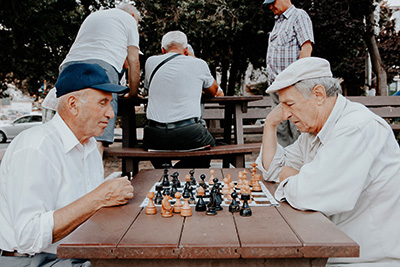 Activities of daily living - Seniors playing chess outdoors